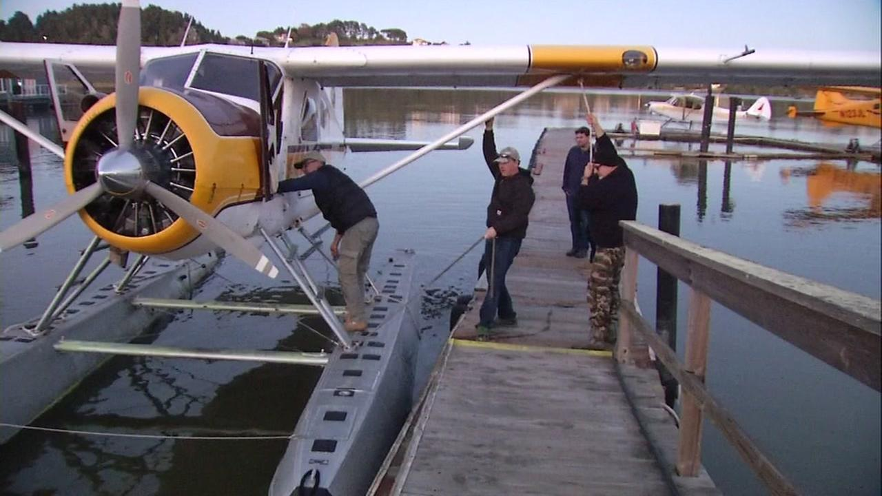 A group of men tie down a plane in Mill Valley, Calif. on Jan. 5, 2017.