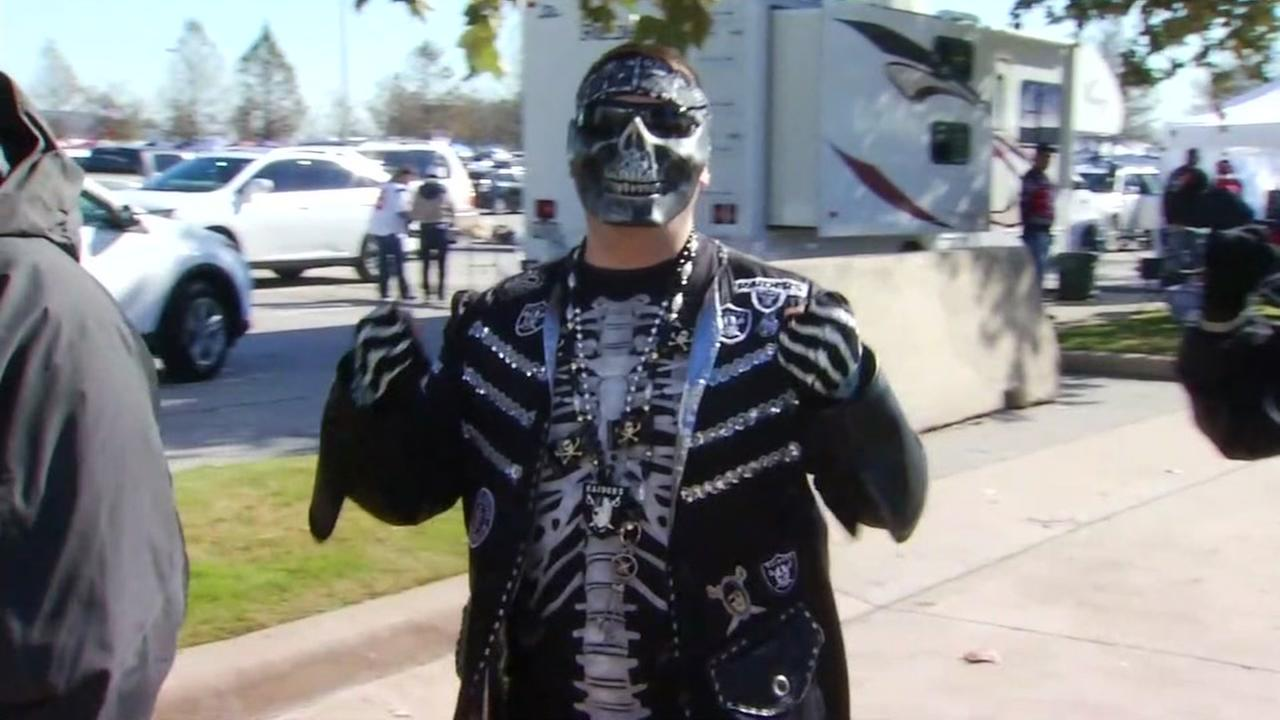 An Oakland Raiders fan appears outside NRG stadium in Houston on Jan. 7, 2016.