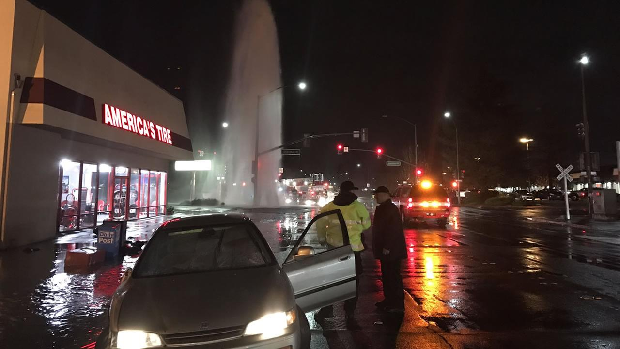 A driver was taken into custody after they missed a turn and took out a fire hydrant in Redwood City, Calif. during a big storm on Jan. 7, 2017.Sergio Quintana/Twitter
