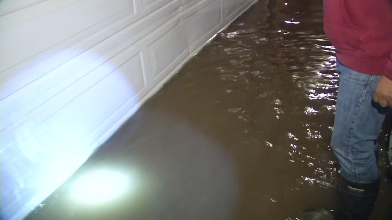 Flood waters reach the garage of the Guevera family in San Martin, Calif. on Jan. 8, 2017.