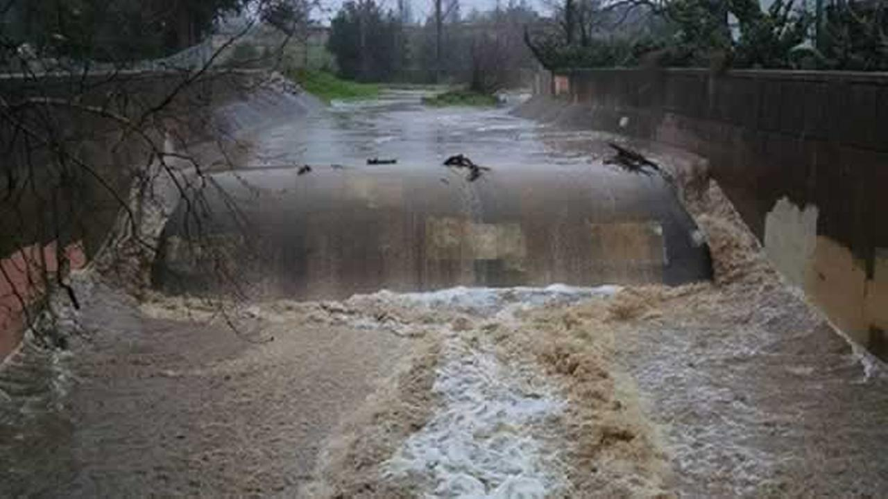 The rainwater flows at San Tomas Aquino Creek in San Jose, Calif. on Sunday, January 9, 2017.