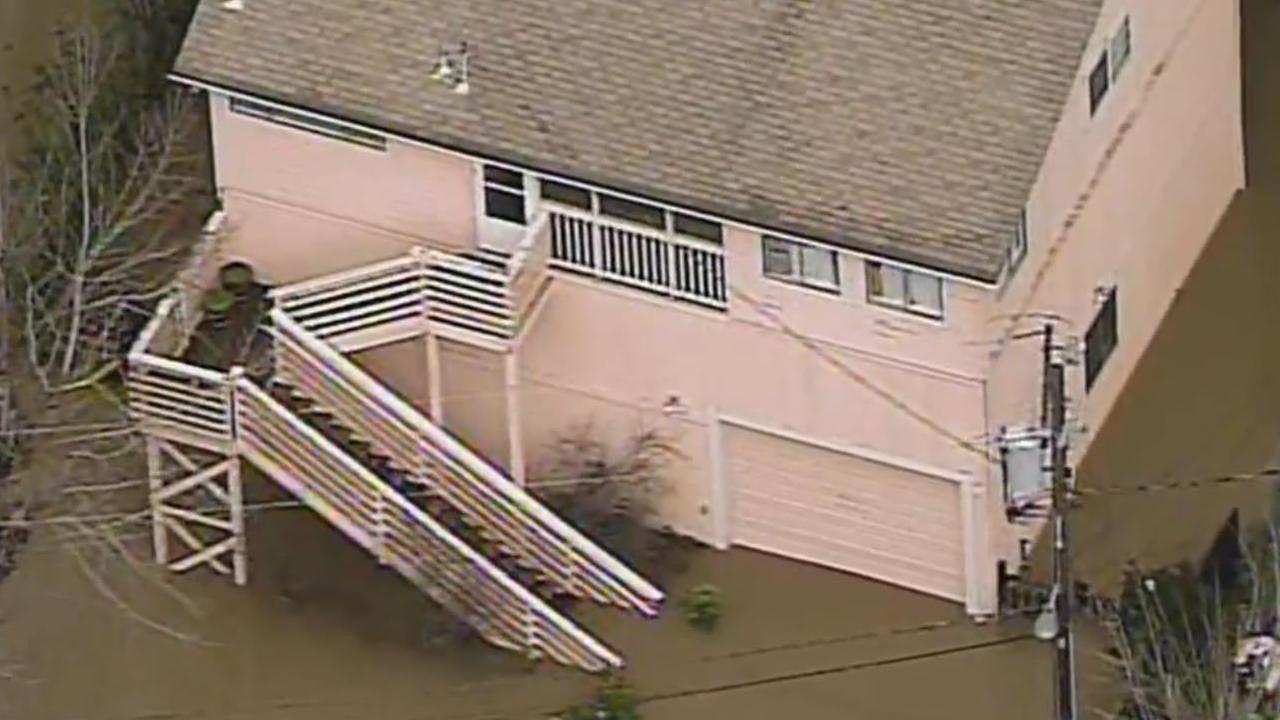 A house is seen submerged in water after a storm in Guerneville, Calif. on Monday, January 9, 2017.KGO-TV