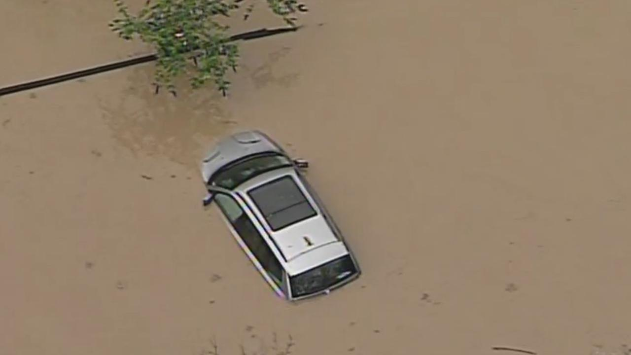 A car is seen submerged in water after a storm in Guerneville, Calif. on Monday, January 9, 2017.KGO-TV