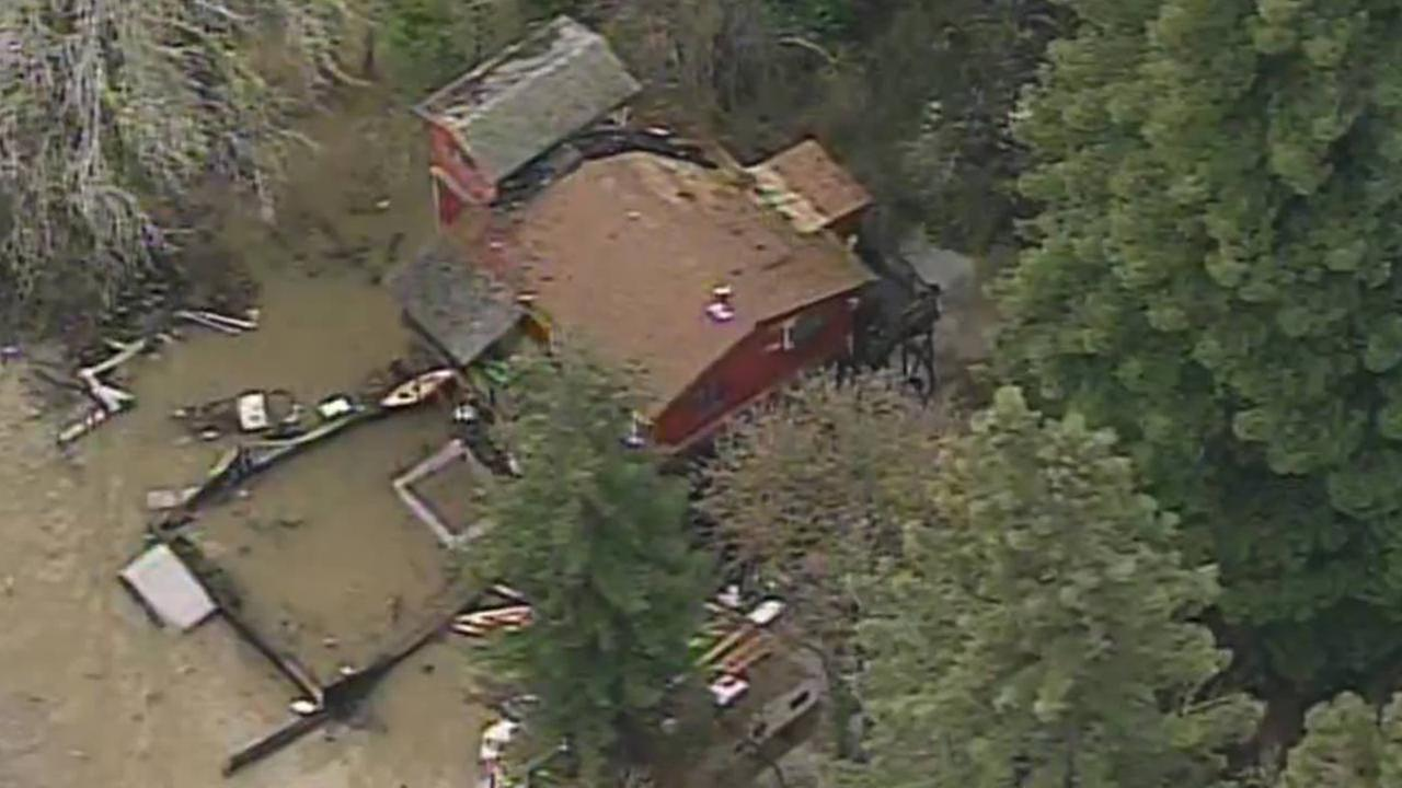 Flooded homes are seen on Monday, January 9, 2017 near the Russian River in Guerneville, Calif. after a storm.KGO-TV