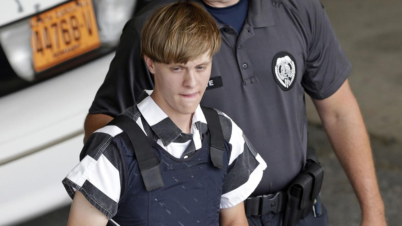 In this June 18, 2015 file photo, Charleston, S.C., shooting suspect Dylann Storm Roof is escorted from the Cleveland County Courthouse in Shelby, N.C.