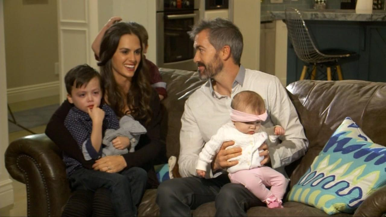 Derek and MKenzie Tillotson sit with their three children in a YouTube video advertising a travel nanny job opening.