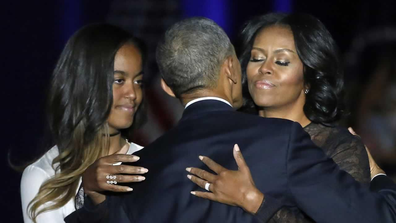 President Barack Obama is joined by his First Lady Michelle Obama and his daughter Malia after giving his presidential farewell address in Chicago, Tuesday, Jan. 10, 2017.