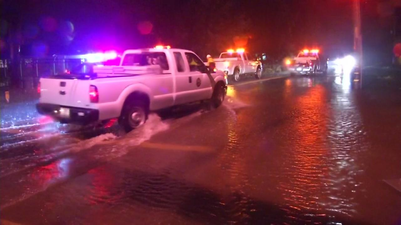 First responders arrive to flooded streets in Gilroy, Calif. on Jan. 10, 2017.