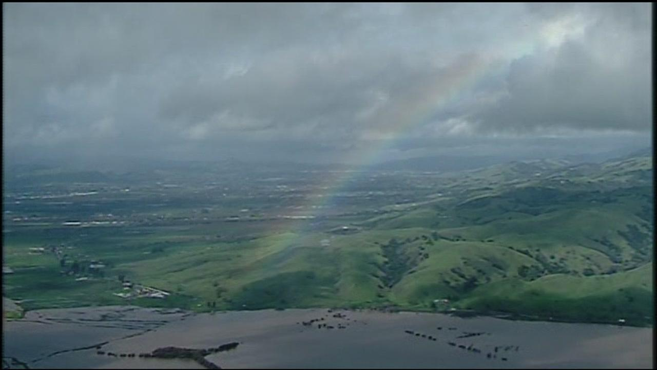 A rainbow appears over the floodwaters in Hollister, Calif. on Wednesday, January 11, 2017.KGO-TV