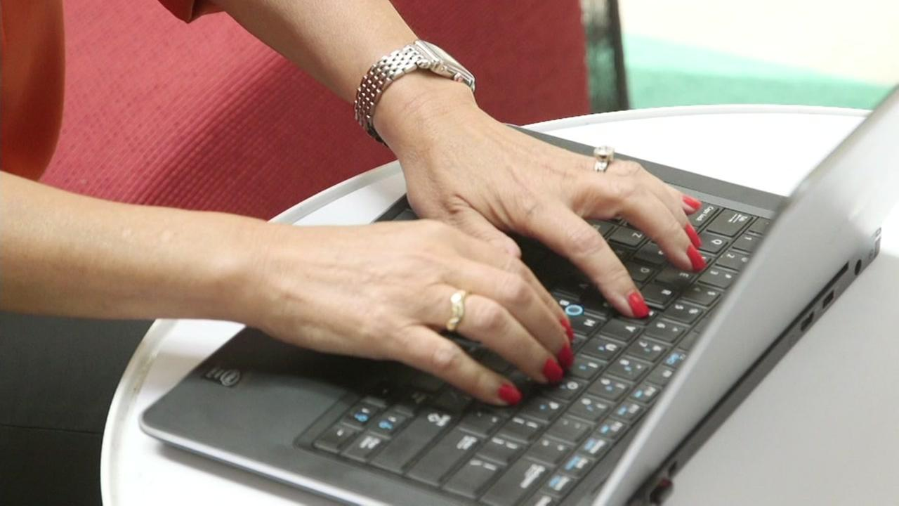 A woman types on a laptop in this undated photo.