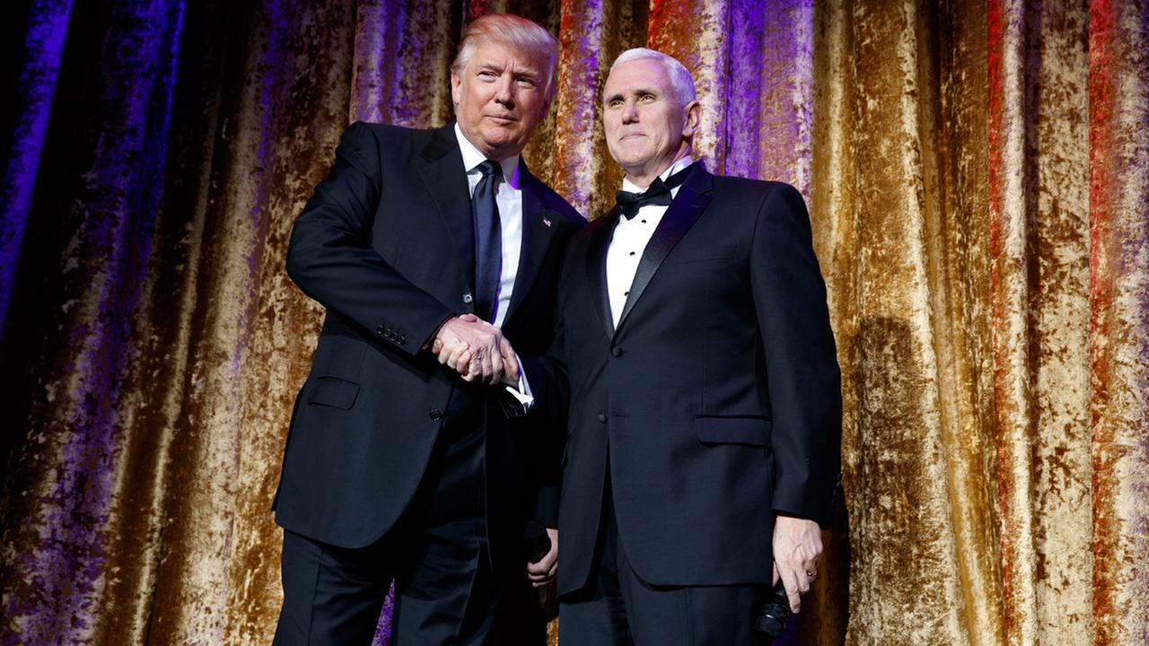 President-elect Donald Trump, left, stands with Vice President-elect Mike Pence during the presidential inaugural Chairmans Global Dinner, Tuesday, Jan. 17, 2017, in Washington.