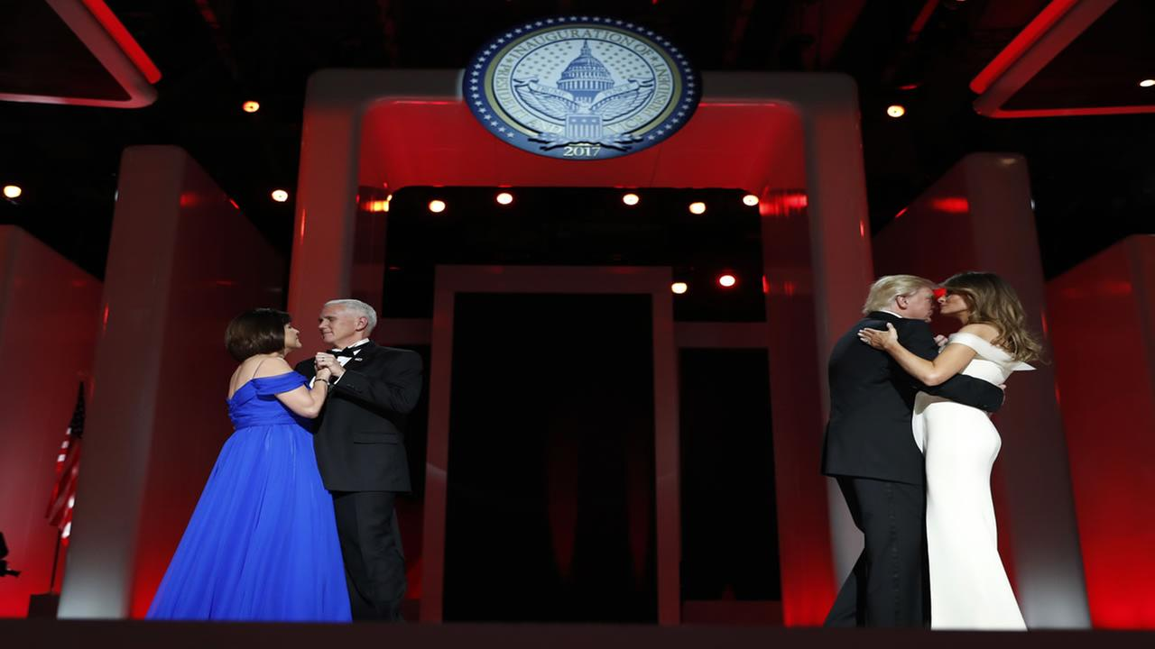 President Donald Trump dances with first lady Melania Trump as Vice President Mike Pence dances with his wife Karen at the Liberty Ball, Friday, Jan. 20, 2017, in Washington. (AP Photo/Alex Brandon)Alex Brandon/AP