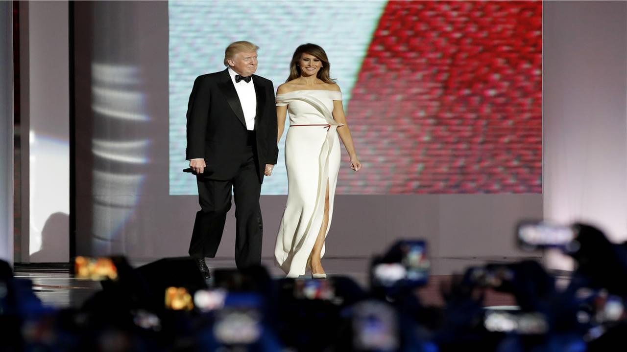 President Donald Trump, left, arrives with first lady Melania Trump at the Liberty Ball, Friday, Jan. 20, 2017, in Washington.Patrick Semansky/AP