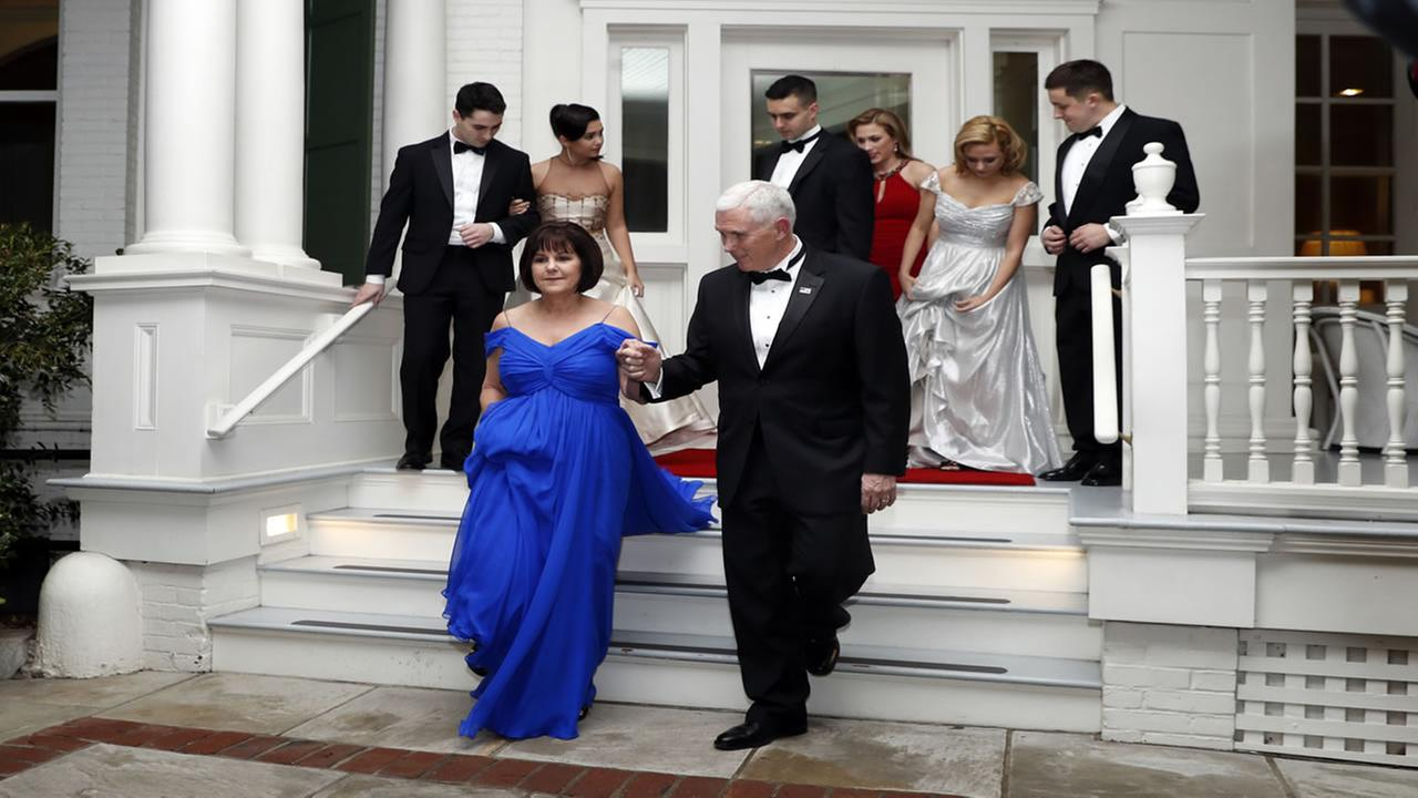 Vice President Mike Pence right, assists his wife Karen Pence as they depart the Naval Observatory for several inaugural balls, Friday, Jan. 20, 2017 in Washington.Alex Brandon/AP