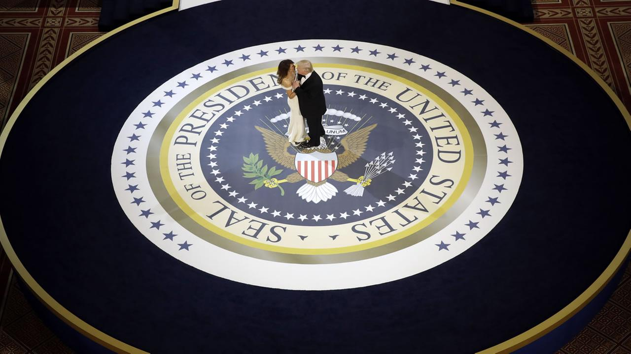 President Donald Trump dances with first lady Melania Trump, at The Salute To Our Armed Services Inaugural Ball in Washington, Friday, Jan. 20, 2017. (AP Photo/Evan Vucci)Evan Vucci/AP