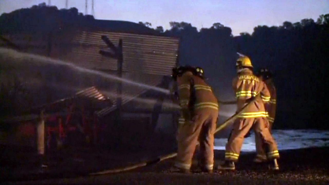 A dead body has been found inside a burning grapevine nursery north of Vacaville in Solano County.