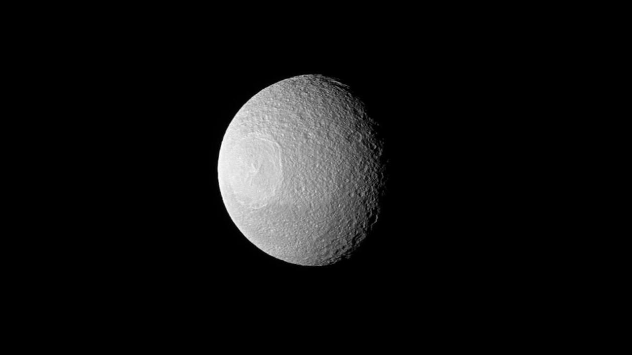 NASA photographs moon orbiting Saturn that resembles Death Star