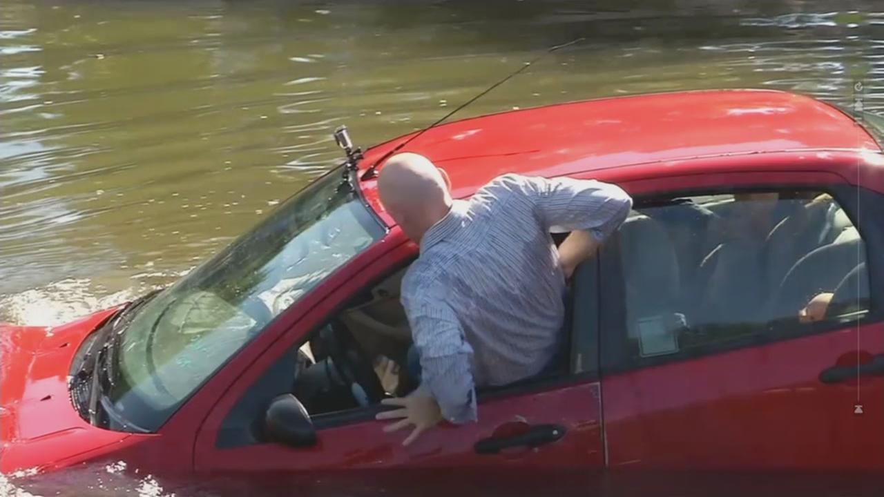 A fire official demonstrates how to get out of a submerged car on Thursday, January 26, 2017.