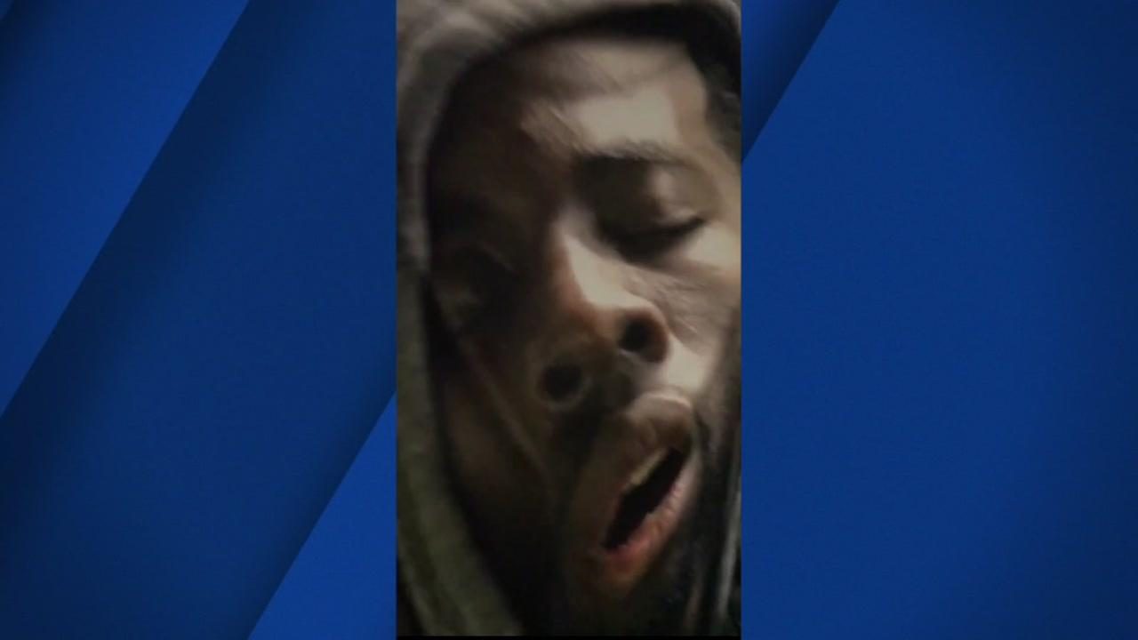 A blanket featuring Warriors star Draymond Green with his mouth wide open, sound asleep is held up while the team is on a flight in this undated photo.