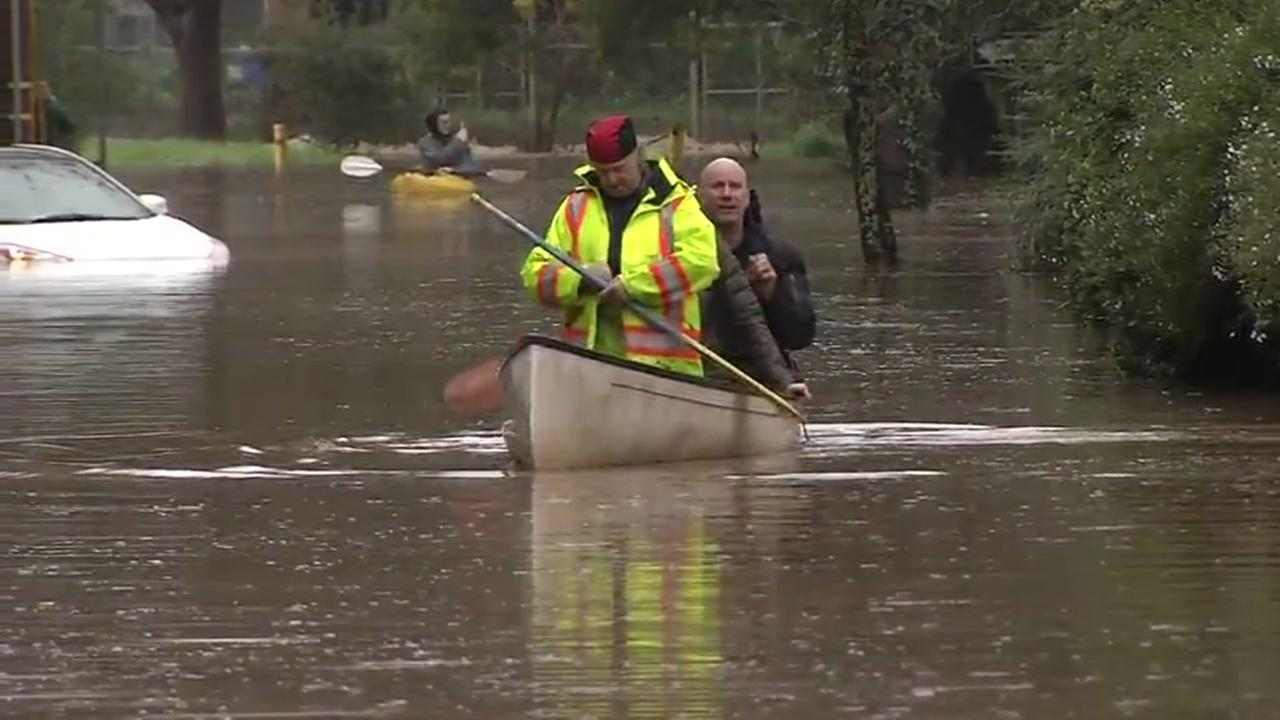 Rescuers paddle through floodwaters in Kentfield, Calif. on Tuesday, Feb. 7, 2017.