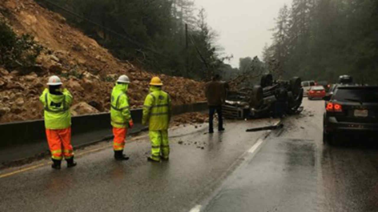 An overturned truck is seen after a landslide on Highway 17 near Scotts Valley, Calif. on Tuesday February 7, 2017.KGO-TV