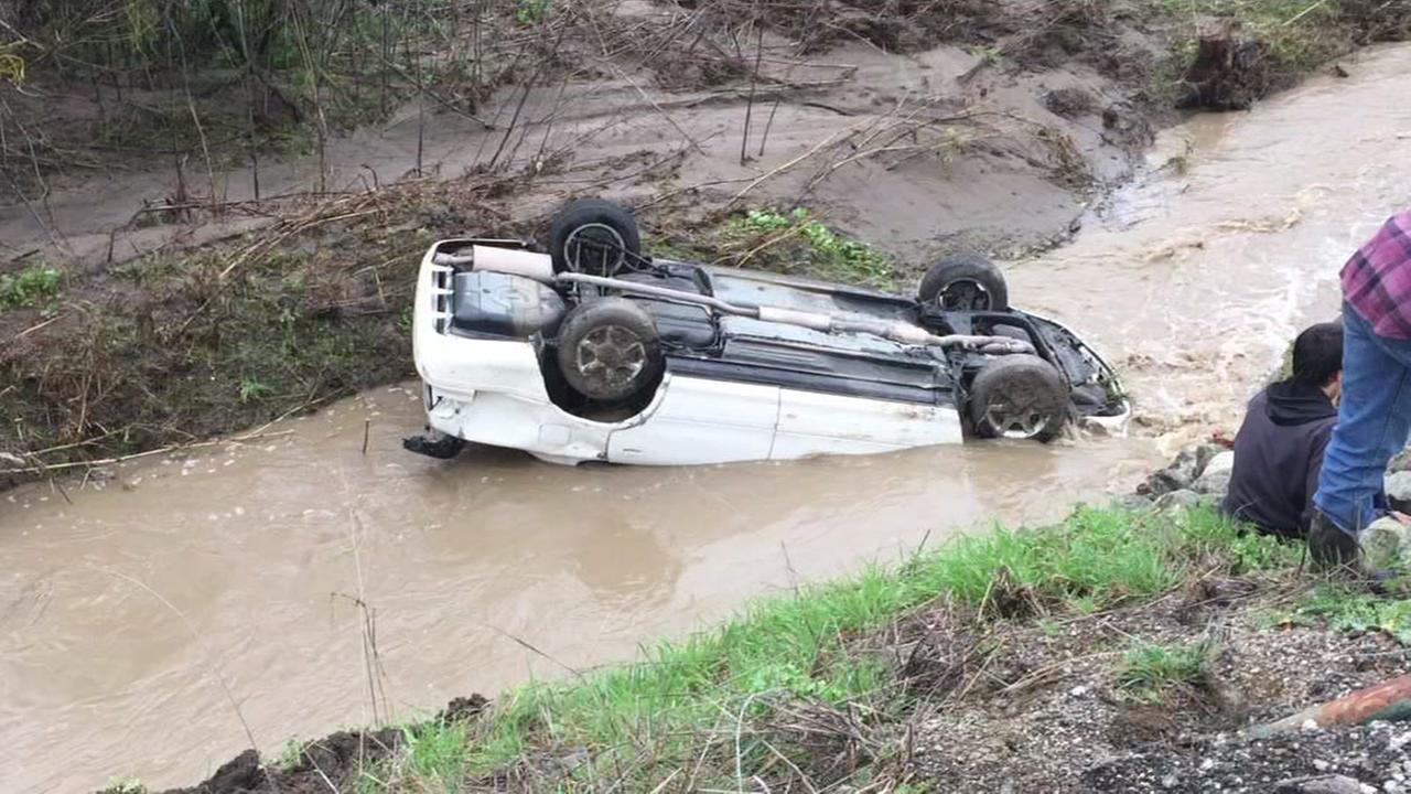 A car flips into Uvas Creek near Dublin, Calif. on Feb. 8, 2017.KGO-TV