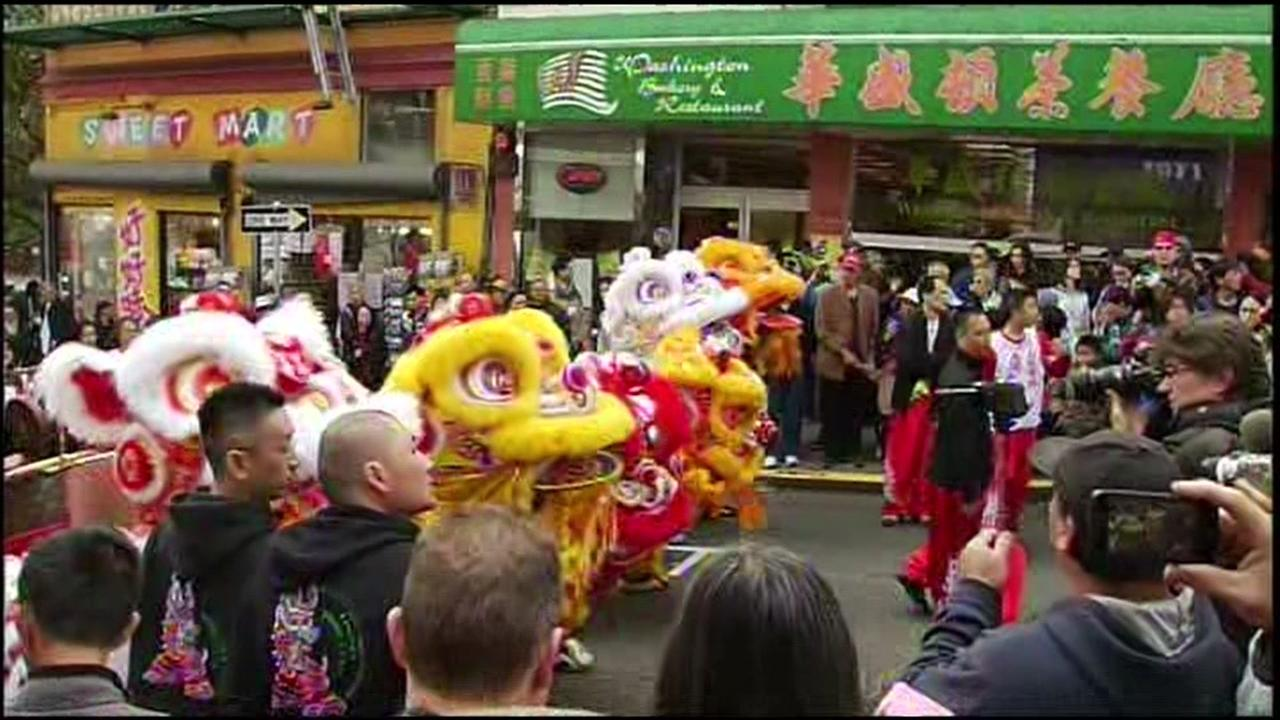 Dragon dancers move down the street at a Chinese New Year parade in San Francisco.