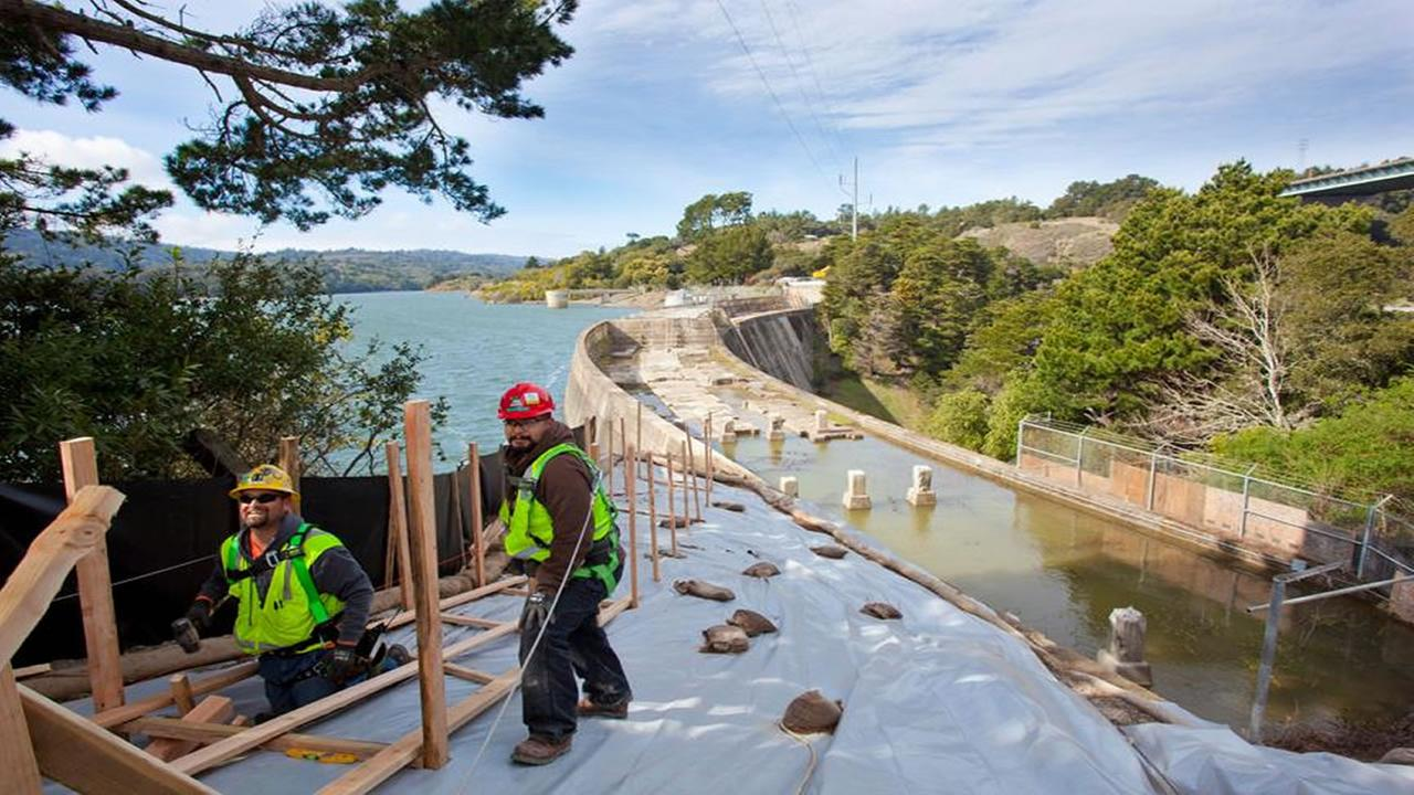 Workers tend to the Crystal Springs Reservoir Dam in San Mateo, Calif. in this undated image.