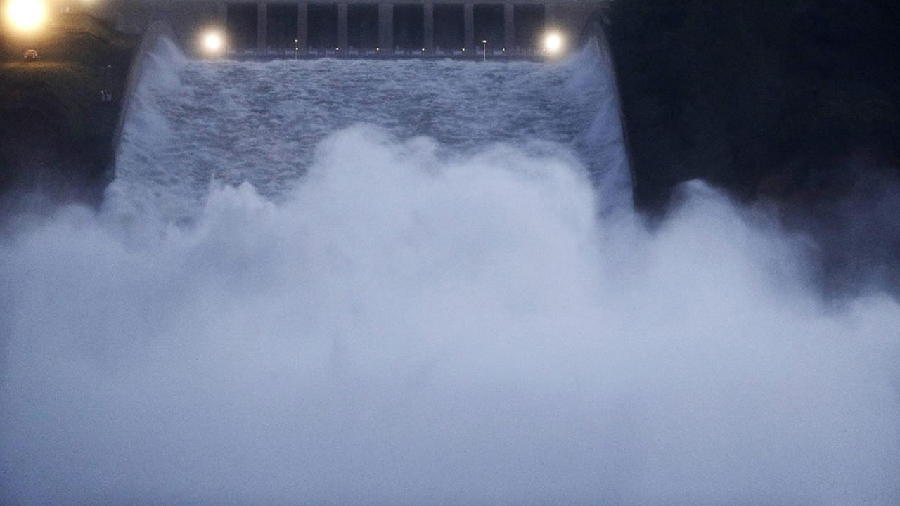 Water gushes from the Oroville Dams main spillway Tuesday, Feb. 14, 2017, in Oroville, Calif.  (AP Photo/Marcio Jose Sanchez)