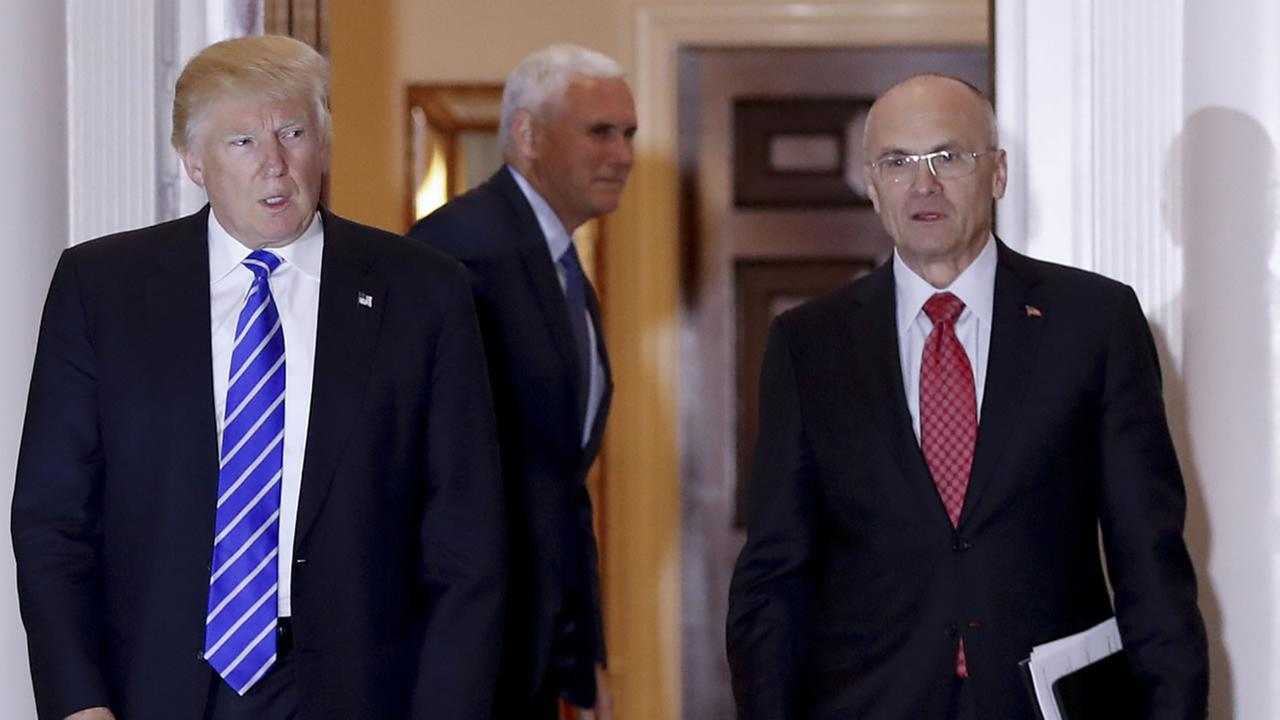 In this Nov. 19, 2016 file photo, President-elect Donald Trump walks Labor Secretary-designate Andy Puzder from Trump National Golf Club Bedminster clubhouse in Bedminster, N.J.