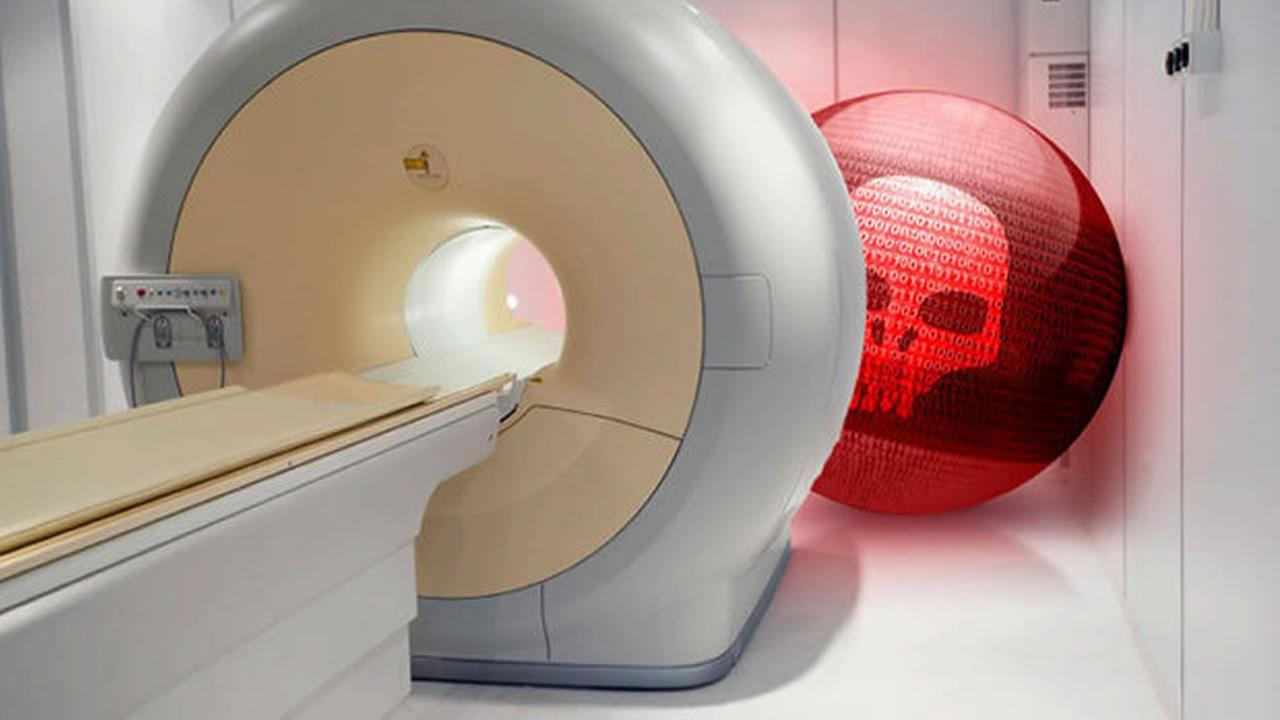 This is an undated image of an MRI machine with graphics from San Mateos TrapX Security.