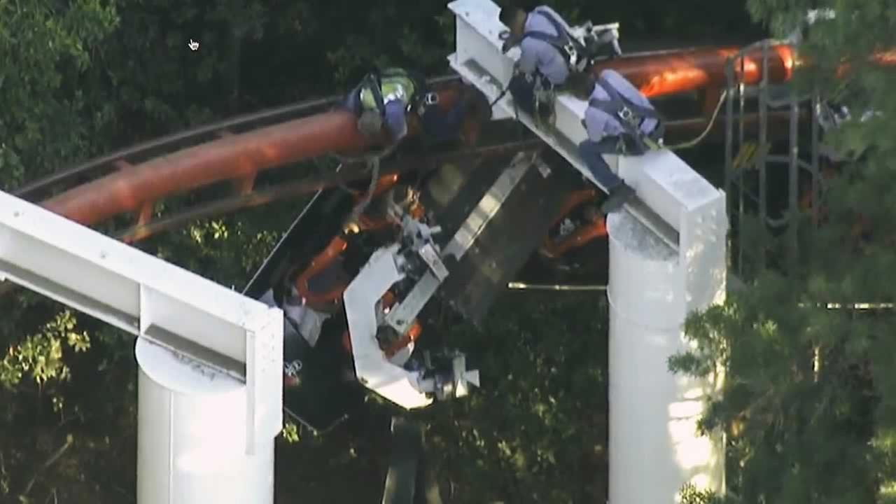 Six Flag Magic Mountain workers rescue people stuck on the Ninja roller coaster
