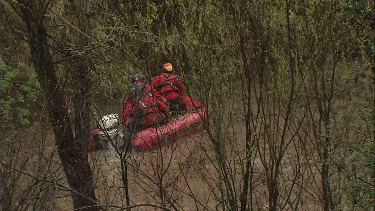 A rescue team saves two people from an island in the missing of a rising Coyote Creek in San Jose, Calif. on Monday, Feb. 20, 2017.KGO-TV