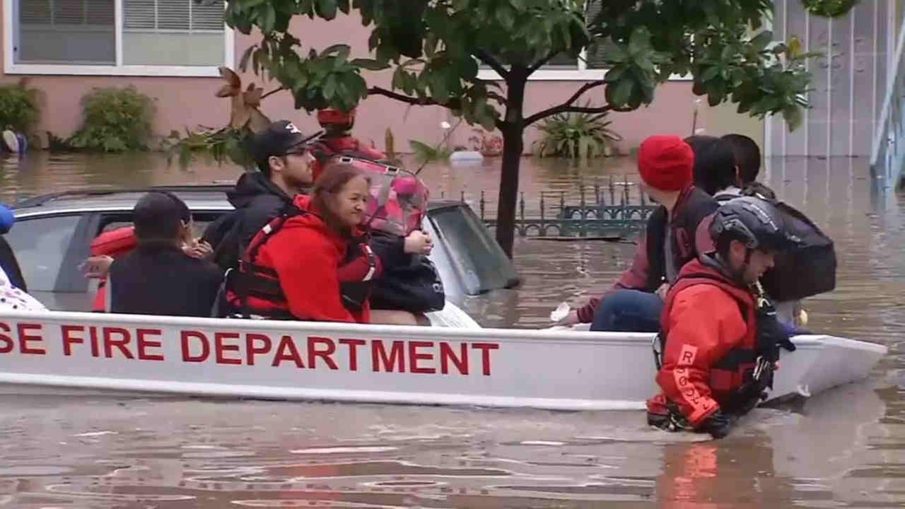 San Jose firefighters rescue dozens of residents by boat in flood waters in the Nordale neighborhood on Tuesday February 21, 2017.