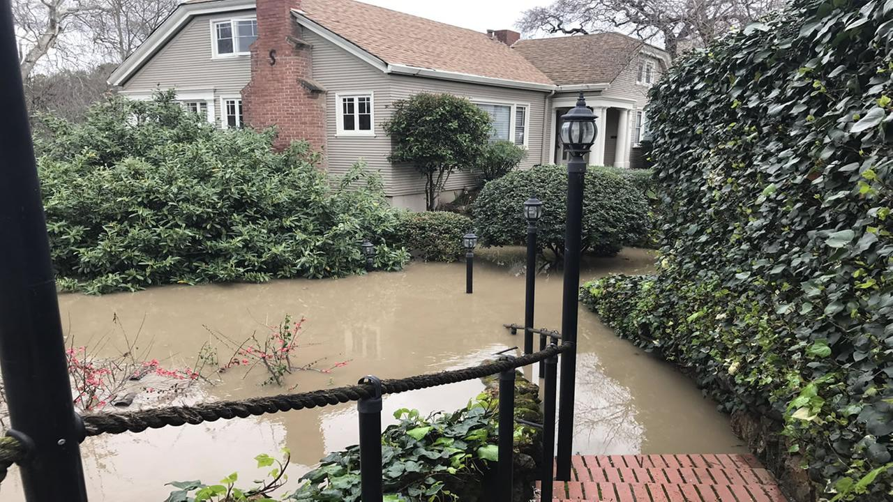 A home in San Jose, Calif. appears submerged under flood waters on Feb. 21, 2017.KGO-TV