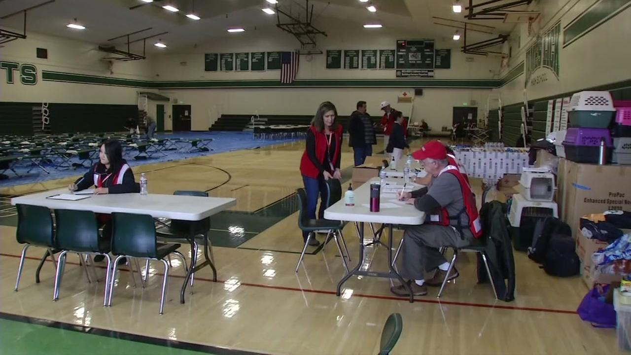 Red Cross volunteers set up an evacuation shelter at James Lick High School in San Jose, Calif. on Tuesday, Feb. 21, 2017.