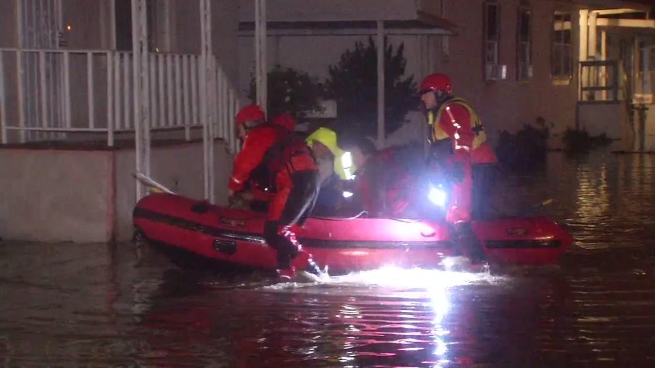 First responders navigate through flood waters with a rescue boat in San Jose, calif. on Feb. 21, 2017.