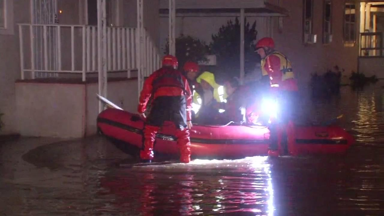 Crews work to rescue residents trapped in flooding in San Jose, California, Tuesday, February 22, 2017.
