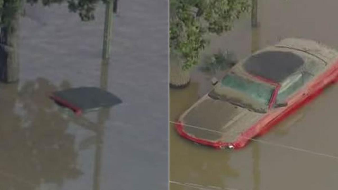 Sky7 shows a car immersed in floodwater on Tuesday, Feb. 21, 2017 (left) and again on Wednesday, Feb. 22, 2017 (right), when floodwaters receded in San Jose, Calif.KGO-TV