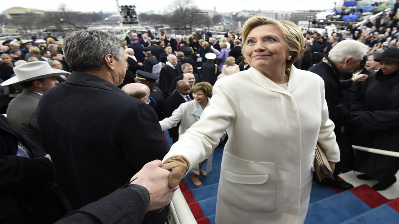 Former US presidential candidate Hillary Clinton leaves after the Presidential Inauguration at the US Capitol in Washington, DC, on January 20, 2017.