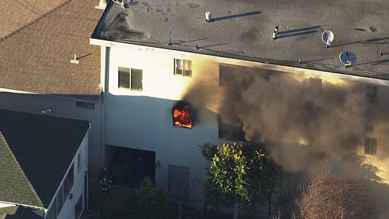 Firefighters are battling a 2-alarm fire on Olive Ave. in South San Francisco, Calif. on Wednesday, March 1, 2017.