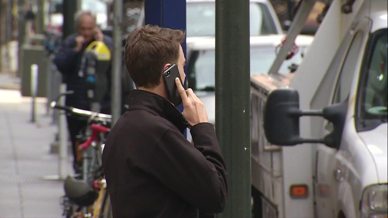 A cellphone user holds it up to his ear in this undated photo.