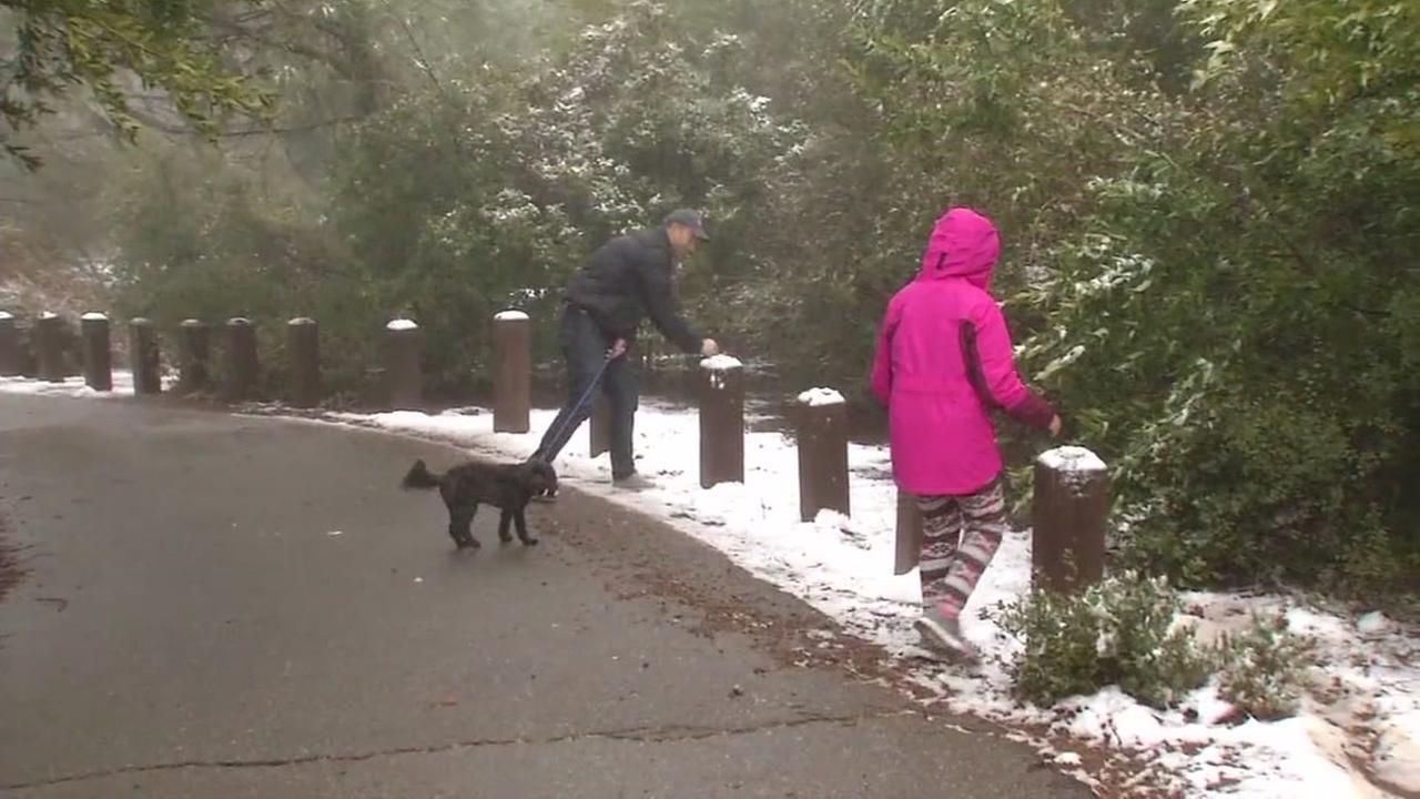 A man and his daughter enjoy snow at the Mount Diablo State Park in Contra Costa County on Monday, March 6, 2017.KGO-TV