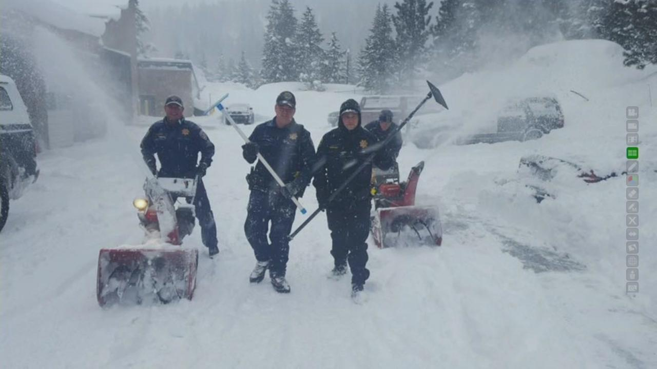 California Highway Patrol officers pose with shovels near Interstate 80 after snowy conditions prompted a closure in Lake Tahoe, Calif. March 6, 2017.
