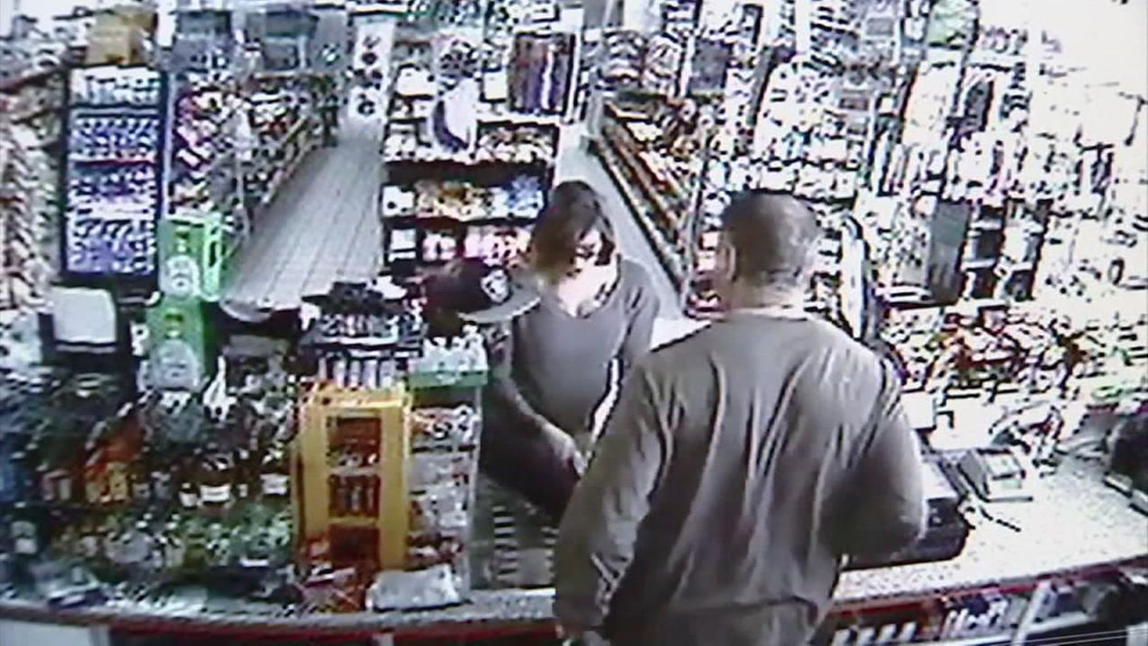A thief snatched a pregnant womans rent money out of a convenience store clerks hand in this surveillance video.