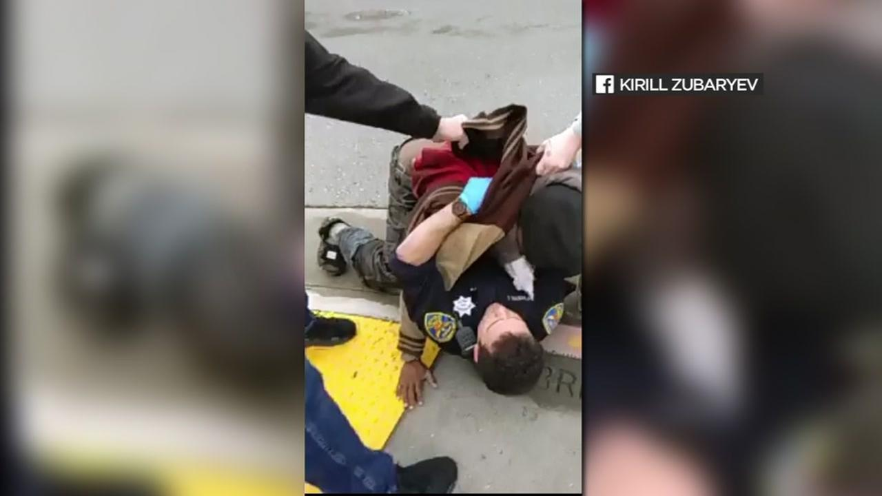San Francisco police say civilians had to come to the rescue of an officer who was attacked by a homeless man in March 2017.