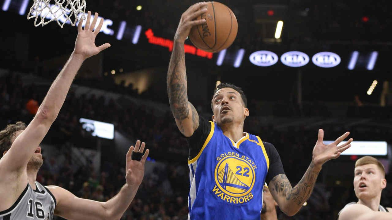 Golden State Warriors forward Matt Barnes (22) grabs the rebound against San Antonio Spurs center Pau Gasol (16).