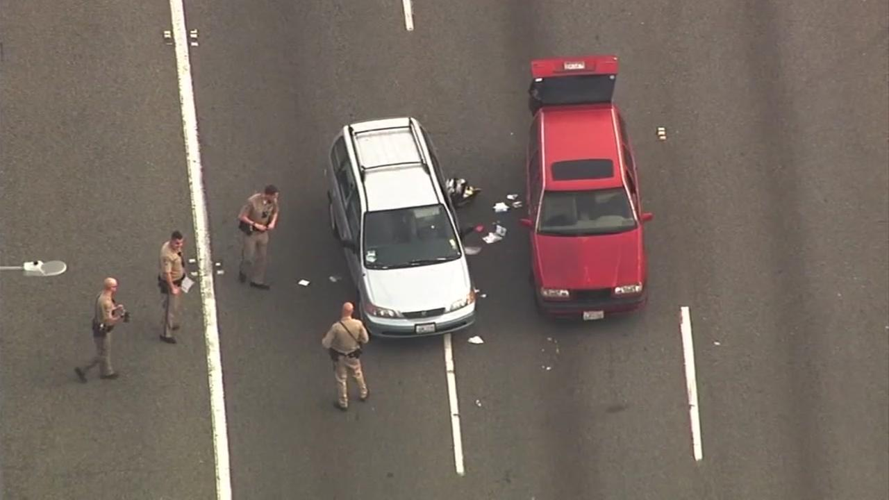Police are seen investigating a shooting on I-80 in Richmond, Calif. on Thursday, March 9, 2017.