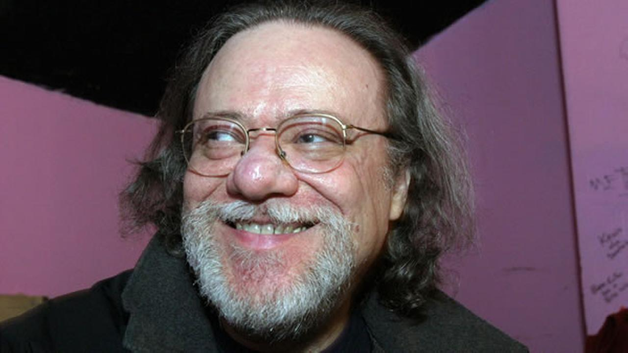 In this Jan. 8, 2005, file photo, Tommy Ramone, ex-drummer and manager of The Ramones, smiles as he is interviewed backstage at the Knitting Factory in New York. AP Photo/Tina Fineberg, File