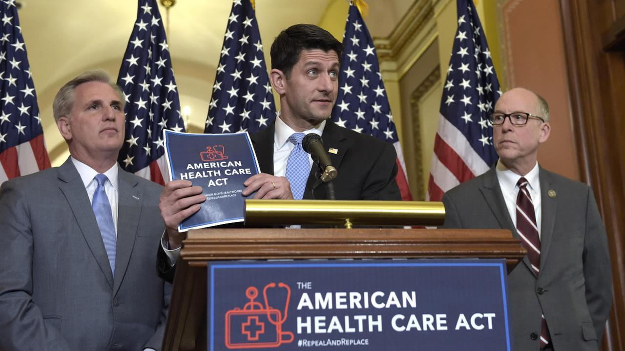 House Speaker Paul Ryan of Wis., center, speaks during a news conference on the American Health Care Act on Capitol Hill in Washington, Tuesday, March 7, 2017.